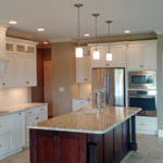 The full kitchen features hanging lights and a kitchen island at 2821 Pat Tillman in Centennial Park, Springfield, Illinois.