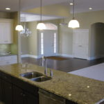 Full kitchen with hanging lights and kitchen island in 5305 Old Savannah Trail, Savannah Pt. in Illinois.